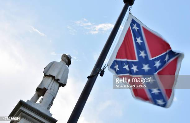 The Confederate flag is seen next to the monument of the victims of the Civil War in Columbia South Carolina on June 20 2015 The racially divisive...