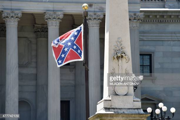 The Confederate flag is seen waving behind the monument of the victimes of the Confederation Army during the American Civil War in front of the State...