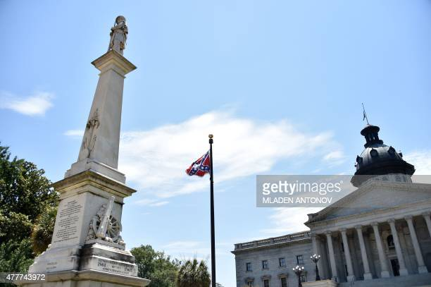 The Confederate flag is seen waving behind the monument of the victims of the Confederation Army during the American Civil War in front of the State...