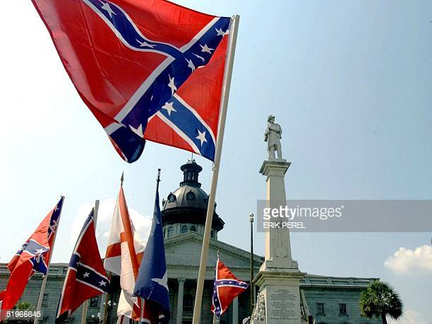 The Confederate flag is waved by supporters in protest of its removal from the Capitol 01 July 2000 in Columbia SC The Confederate flag was removed...