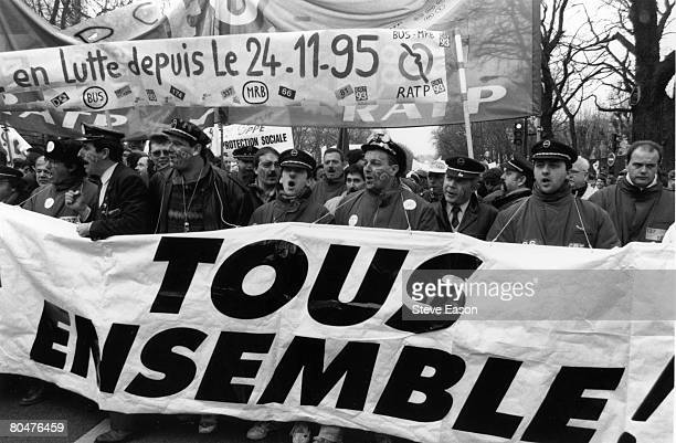 The Confederation Generale du Travail in Paris join a million people throughout France demonstrating against Juppe's welfare cuts during the three...