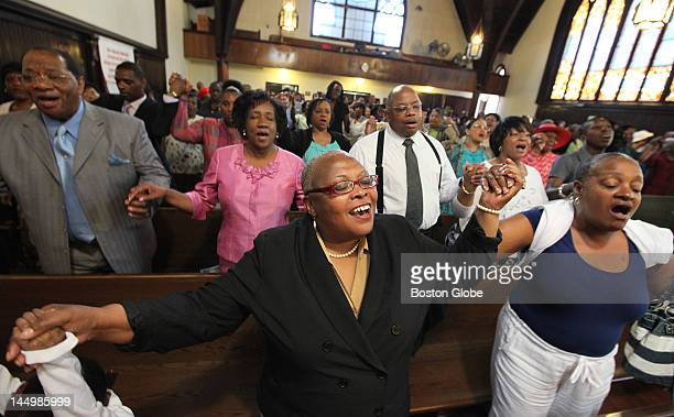 The congregation holds hands and sings at Grant AME Church where Donna Summer once worshipped near the end of its regular service on Sunday May 20...