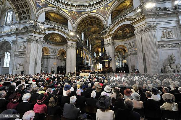 The congregation listen as Archbishop of Canterbury Dr Rowan Williams reads during the service of thanksgiving to mark the Queen's Diamond Jubilee at...