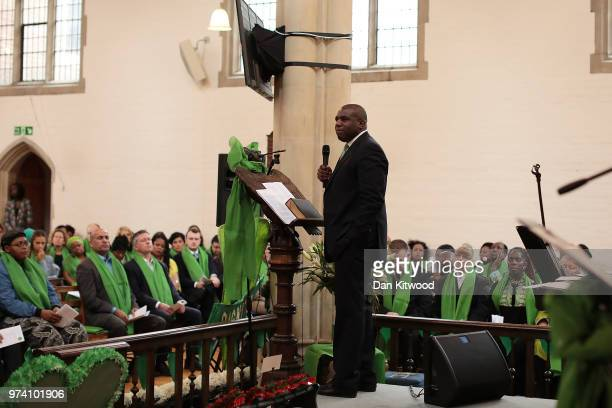 The congregation listen to Labour Party MP for Tottenham David Lammy give a speech during a memorial service at St Helen's Church to mark the one...