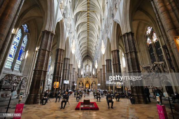 The congregation sit on socially distanced chairs during a service to mark the 80th anniversary of the Battle of Britain at Westminster Abbey on...