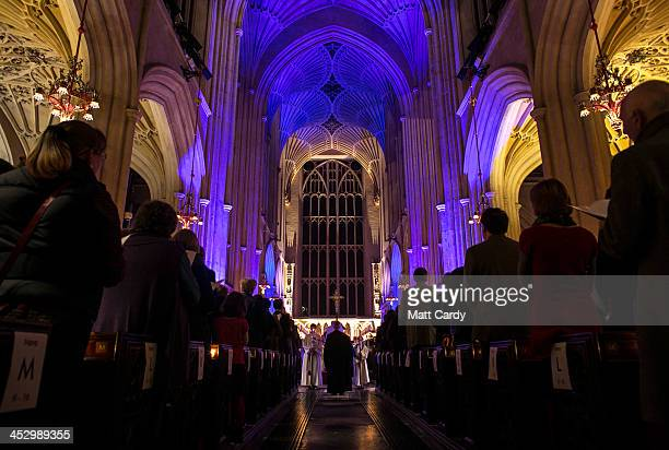 The congregation watch as choristers take part in Bath Abbey's candlelit Advent Procession on December 1 2013 in Bath England One of the most popular...