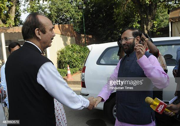 The congress leader Ghulam Nabi Azad and BJP leader Prakash Javdekar during the monsoon session at the Parliament House on August 3 2015 in New Delhi...