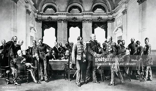 The Congress of Berlin July 13 painting by Anton von Wernerin with Bismarck in the foreground between Andrassy and Shuvalov and shakings hands with...