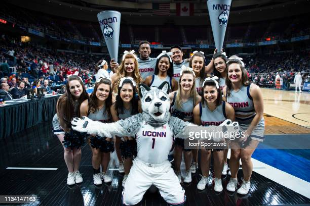 The Connecticut Cheerleaders and Mascot pose for a photo prior to the first half of the game between the Connecticut Huskies and the Louisville...