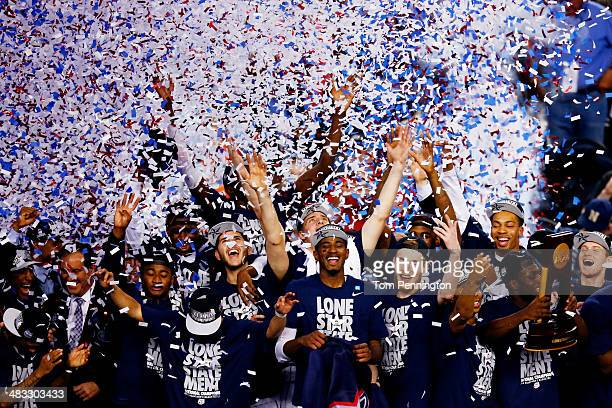 The Connecticut Huskies celebrate after defeating the Kentucky Wildcats 60-54 in the NCAA Men's Final Four Championship at AT&T Stadium on April 7,...