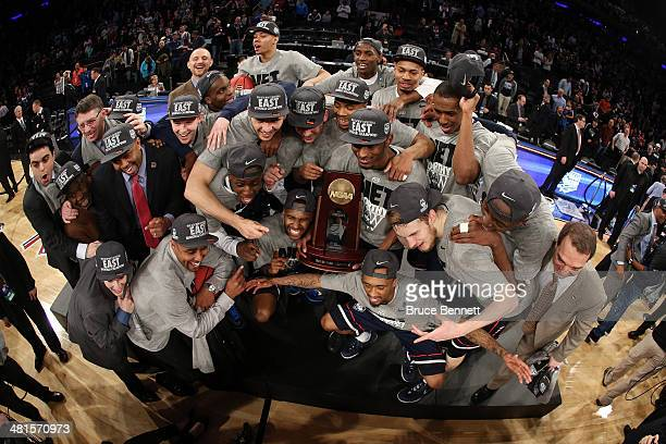 The Connecticut Huskies celebrate with the trophy after defeating the Michigan State Spartans during the East Regional Final of the 2014 NCAA Men's...