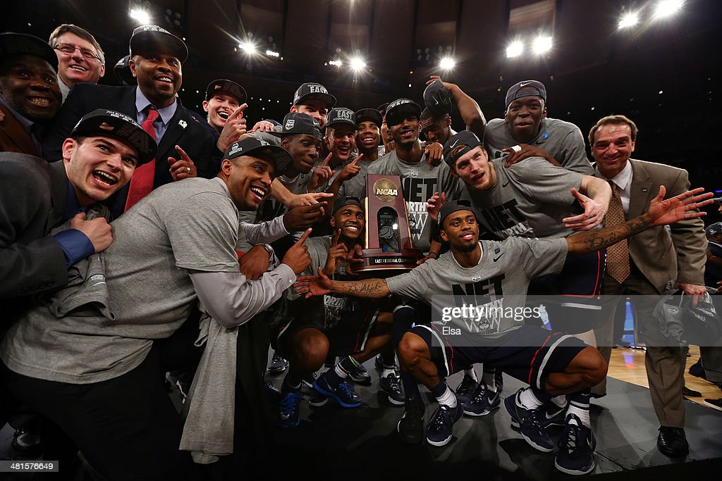 The Connecticut Huskies celebrate with the trophy after defeating the Michigan State Spartans during the East Regional Final of the 2014 NCAA Men's Basketball Tournament at Madison Square Garden on March 30, 2014 in New York City.