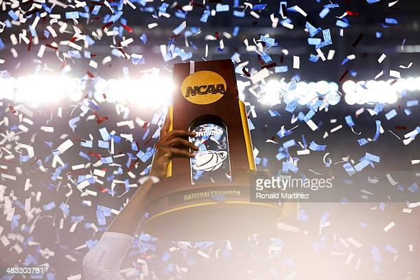 The Connecticut Huskies celebrate with the trophy after defeating the Kentucky Wildcats 60-54 in the NCAA Men's Final Four Championship at AT&T...