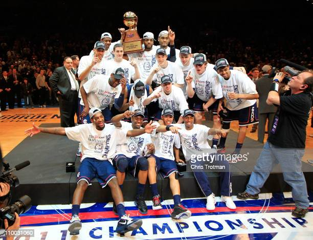 The Connecticut Huskies celebrate with their trophy after defeating the Louisville Cardinals during the championship of the 2011 Big East Men's...