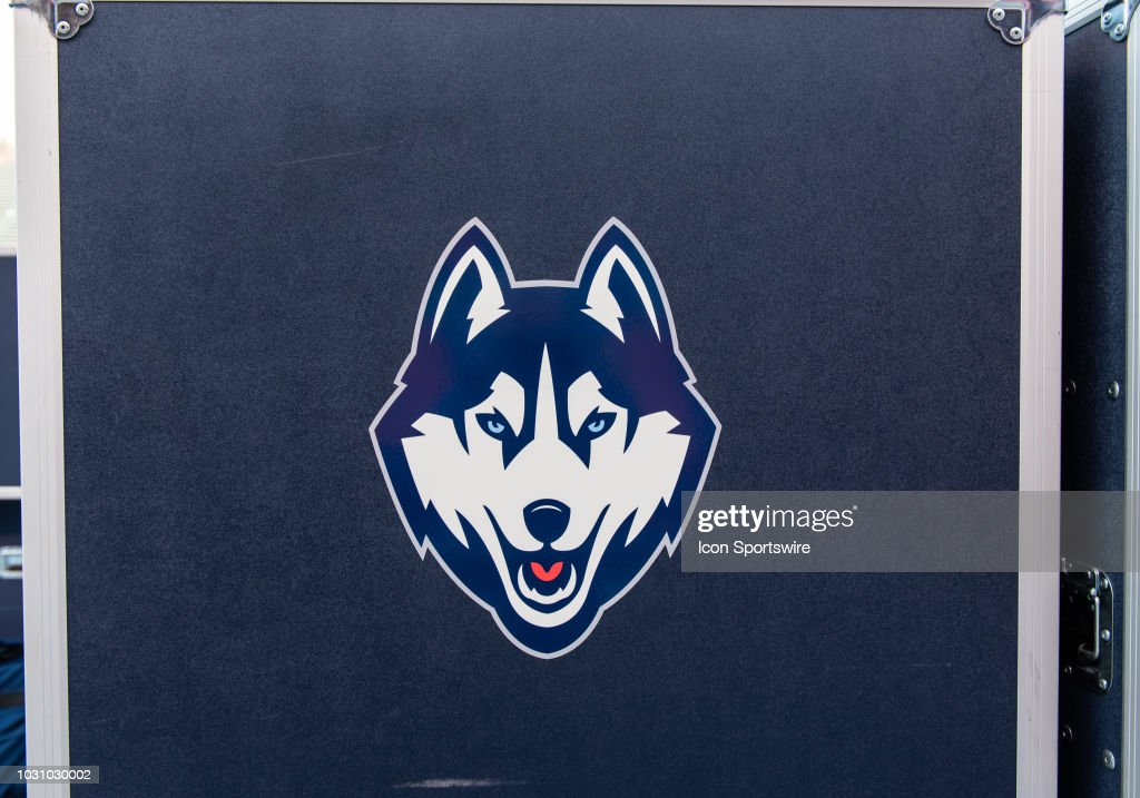 The Connecticut Huskies Logo On An Equipment Box At The Game Between
