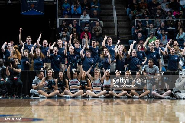 The Connecticut Huskies Pep Band and Cheerleaders cheer for their team during the first half of the game between the Connecticut Huskies and the...