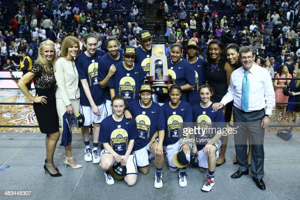 The Connecticut Huskies pose after defeating the Notre Dame Fighting Irish 79 to 58 in the NCAA Women's Final Four Championship at Bridgestone Arena...