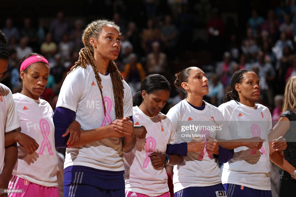 The Connecticut Sun and the Phoenix Mercury stand for a moment of silence for the National Anthem before the game on August 20, 2017 at Mohegan Sun Arena in Uncasville, CT.