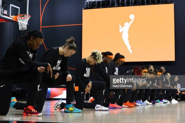 The Connecticut Sun kneel for the National Anthem prior to a game against the Washington Mystics on July 28 2020 at Feld Entertainment Center in...