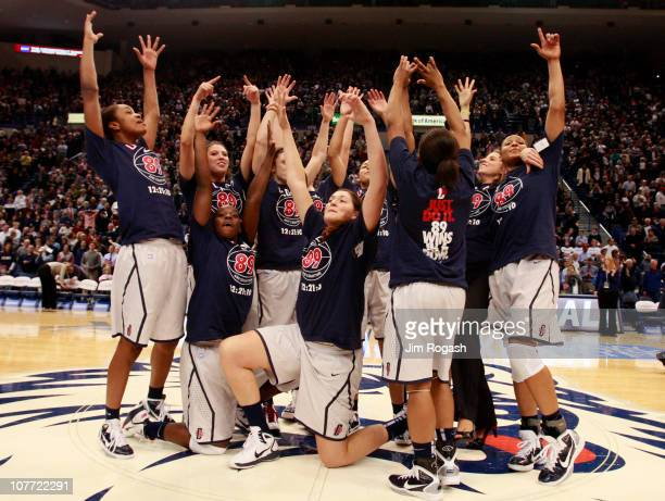 The Connecticut women's basketball team celebrates after a win over Florida State on December 21 2010 in Hartford Connecticut Connecticut set a...
