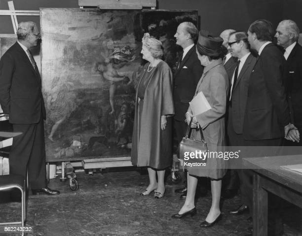 The Conservative MPs who supported the restoration of Titian's painting 'Bacchus and Ariadne' examine the results at the National Gallery in London...