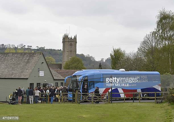 The Conservative Party campaign bus arrives for a UK general election campaign event in Norton Sub Hamdon near Yeovil south west England on April 25...