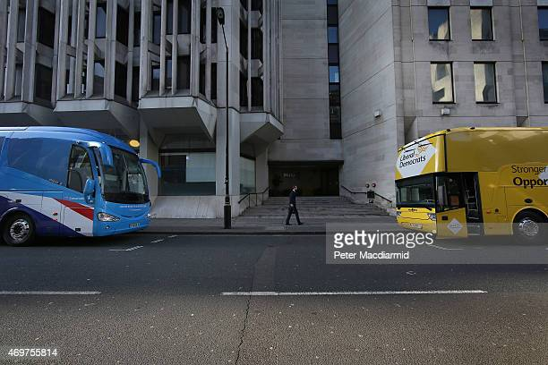 The Conservative party election bus faces the Liberal Democrat bus ahead of a day of campaigning on April 15 2015 in London England Today the United...