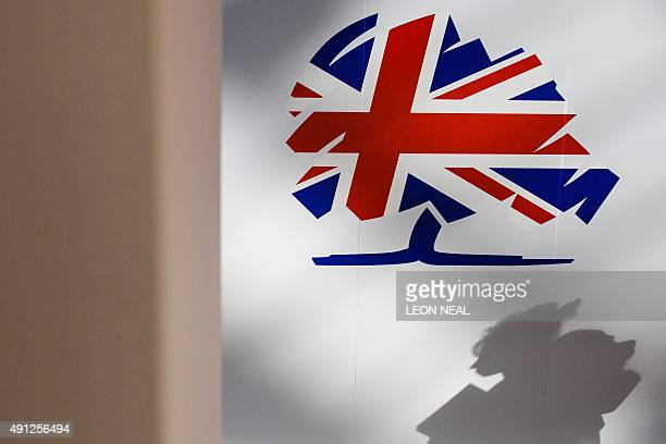 The Conservative party logo is displayed on the first day of the annual Conservative party conference in Manchester north west England on October 4...