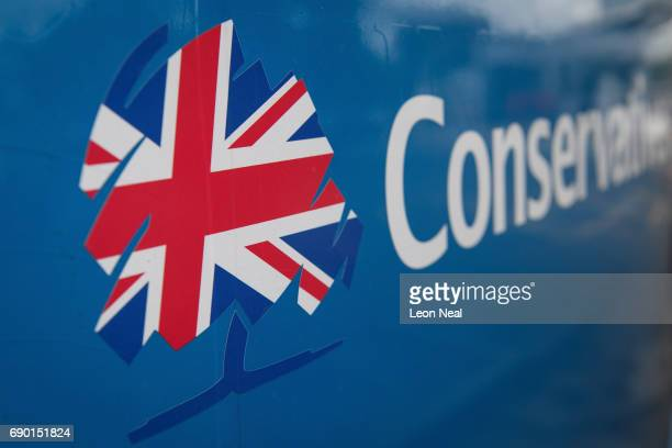 The Conservative party logo is seen on the Conservative election battle bus as it waits in a motorway services car park ahead of a visit to Simon...