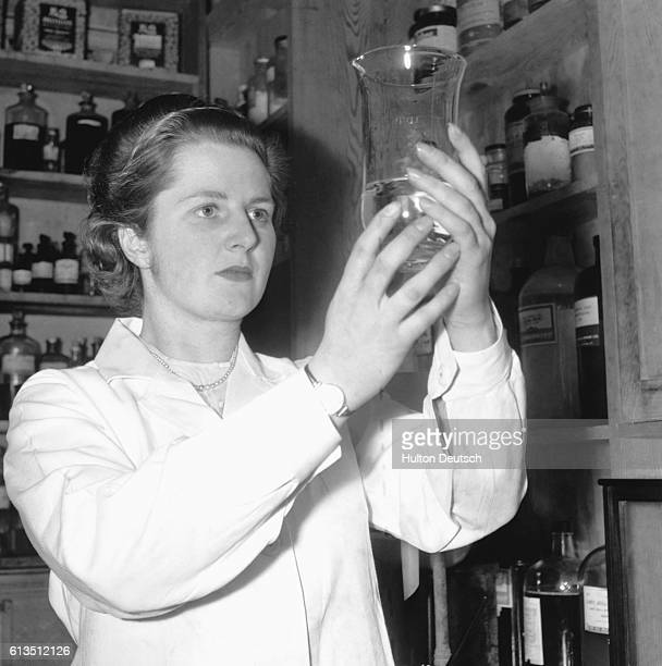 The Conservative politician and candidate for Dartford Margaret Thatcher at work whilst a research chemist 1950
