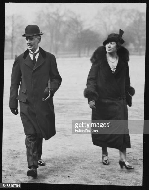 The Conservative politician and Chancellor of the Exchequer Neville Chamberlain with his wife on their way to Downing Street on budget day