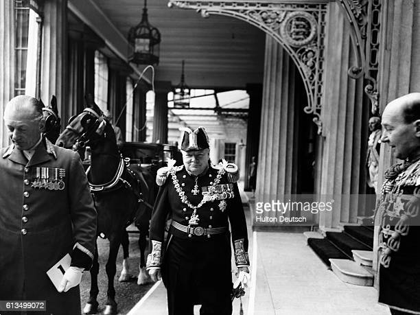 The Conservative Prime Minister Winston Churchill in military uniform prepares to leave Buckingham Palace in a horse drawn carriage to journey to...