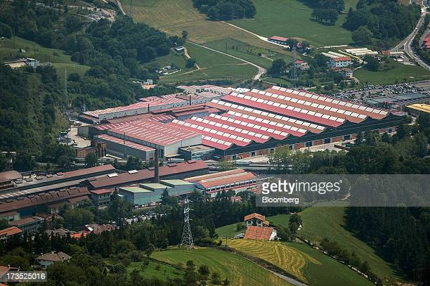 The Construcciones y Auxiliar de Ferrocarriles SA railway rolling stock manufacturing plant complex is seen from above in Beasain Spain on Monday...