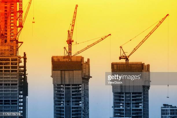 the construction of chongqing chaotianmen raffles city building - visual_effects stock pictures, royalty-free photos & images
