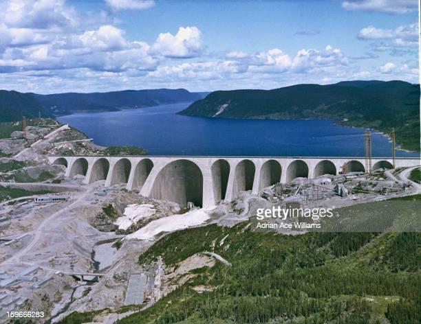 The construction of the DanielJohnson Dam on the Manicouagan River Quebec Canada circa 1965