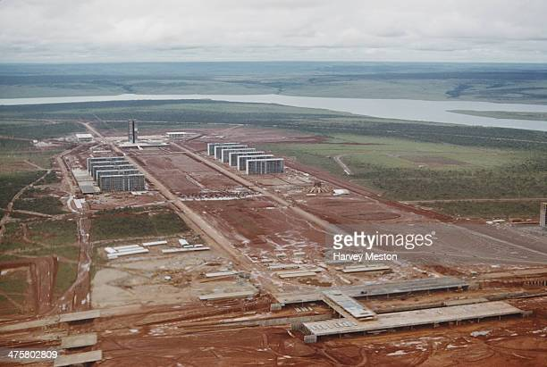 The construction of the Esplanada dos Ministerios on the Monumental Axis in Brasilia Brazil with the Cathedral of Brasilia on the right and the...