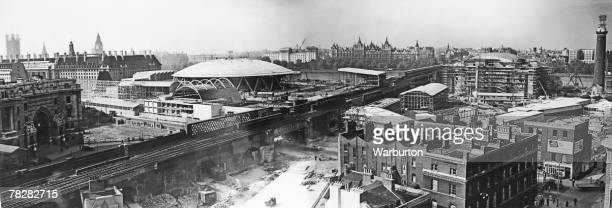The construction of the Festival of Britain site on London's South Bank October 1950 Waterloo Station is on the left with County Hall behind it and...