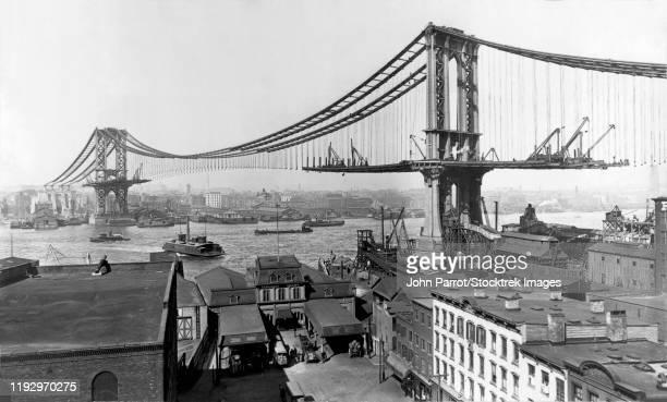 the construction of the manhattan bridge during 1901-1909. - 1900 1909 photos et images de collection