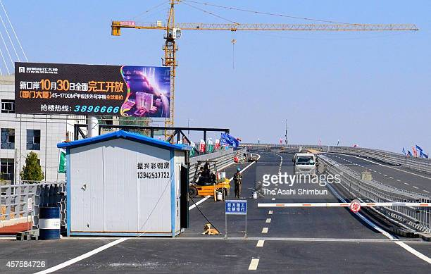 The construction of the new bridge over Yalu River which connects Dandong of China and Sinuiju of North Korea continues on October 16 2014 in Dandong...