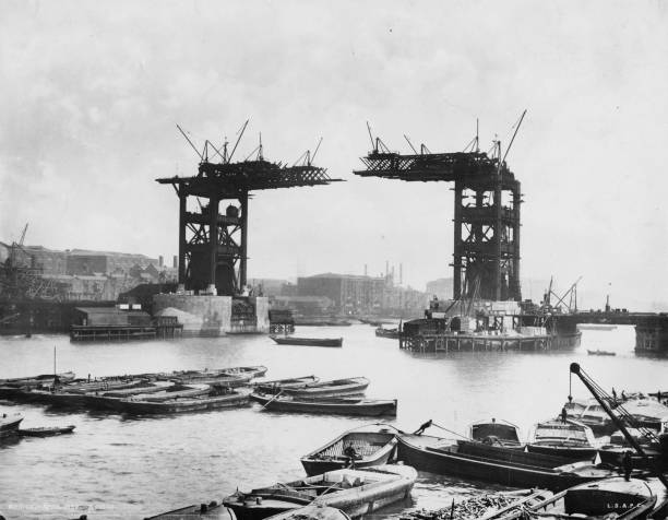 The construction of Tower Bridge, London, which was...
