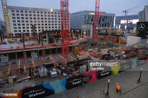 The construction site of a high-rise buildings stands among other recently-built commercial buildings at the Mercedes Platz development in...