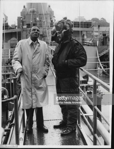 The Consul for the United States Mr O Taft looks at the weather yesterday as be visits the 4440ton tanker USS Nespelen in Sydney on its way back to...