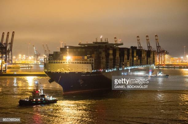 The container ship 'Antoine de Saint Exupery' operated by the French CMA CGM shipping company runs into the port of Hamburg northern Germany on March...