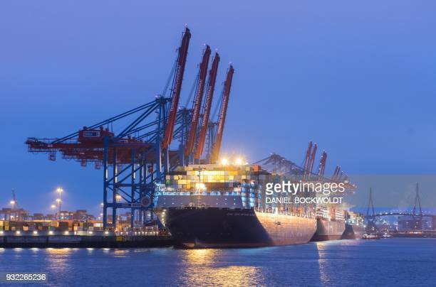 The container ship 'Antoine de Saint Exupery' operated by the French CMA CGM shipping company moores at the Burchardkai terminal of the port of...