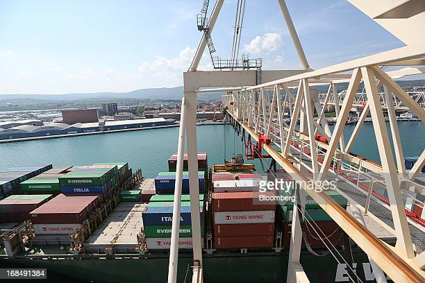 The container ship Ever Ultra operated by Evergreen Marine Corp Taiwan Ltd stands beneath gantry cranes at the dockside in the port of Koper operated...