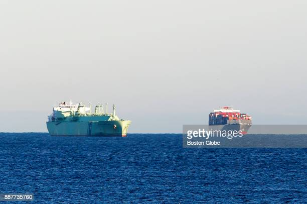The container ship Helsinki Bridge right is anchored off of Nahant after it drifted away from the Paul J Conley Container Terminal in South Boston on...