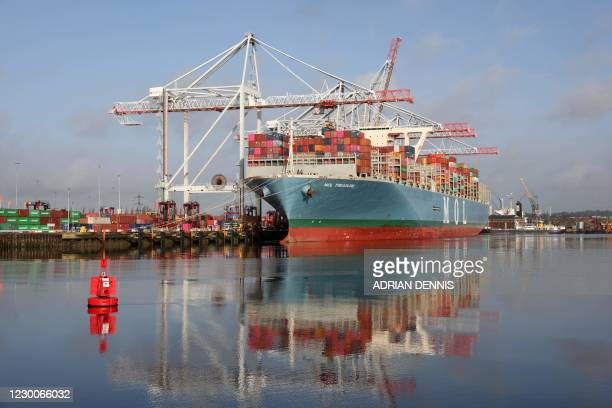 The Container Ship, MOL TREASURE is moored at Southampton Docks in Southampton on the south coast of England on December 11, 2020. - Food shortages,...