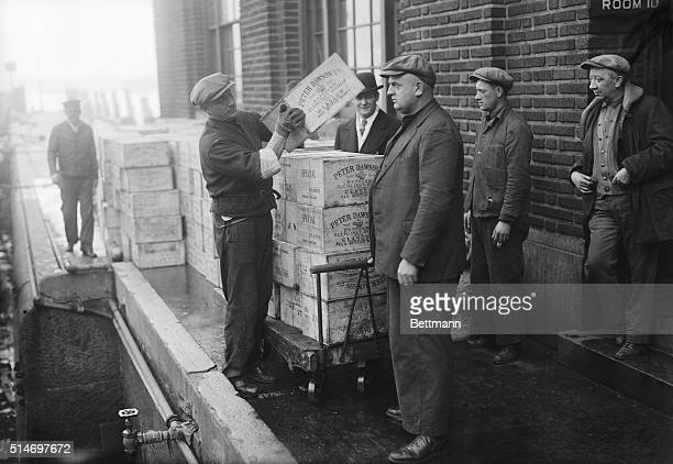 1928 The contents of a Prohibitionera rumrunner being emptied out after being caught by Coast Guard