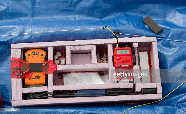 The contents of the payload include from left GPS unit GO PRO video camera HAM radio green beans marshmallows and a plaque recognizing Peel school...
