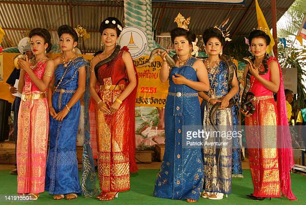 The contestants for Miss King Cobra line up on stage during the Buddhist New Year ceremony for the King Cobra during April 2010 in Ban Khok...